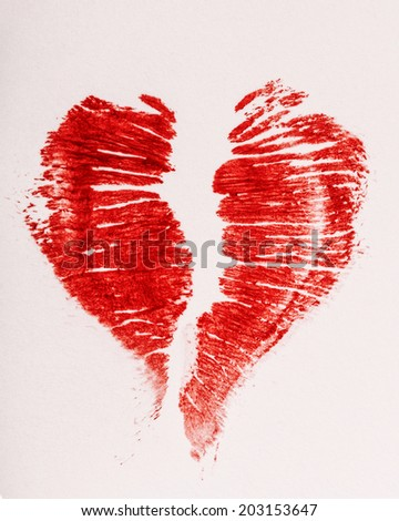 Imprint of female lips red lipstick in the form of heart on a napkin - stock photo