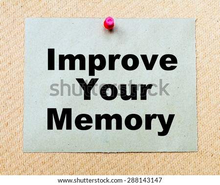Improve Your Memory written on paper note pinned with red thumbtack on wooden board. Business conceptual Image - stock photo