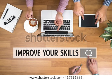 IMPROVE YOUR SKILLS man touch bar search and Two Businessman working at office desk and using a digital touch screen tablet and use computer, top view - stock photo