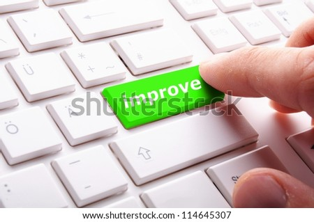 improvement or improve on key or button showing investment concept - stock photo