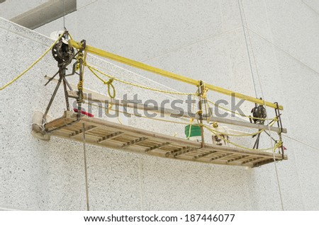 Improvised scaffolding  Framework made to repair recently built walls  - stock photo