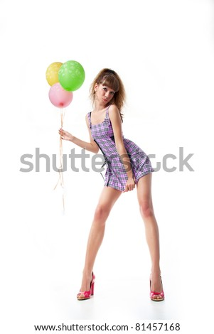 Impudent girl with balloons - stock photo