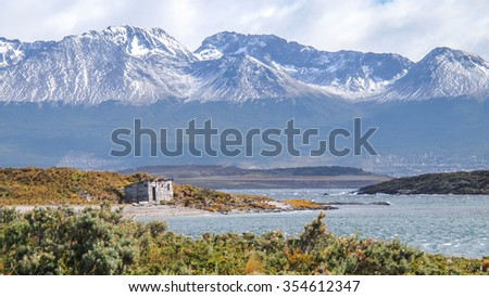 In a litle island in the middle of the Beagle Channel, in Ushuaia, a small house build of wood is like a drop of water in a desert.  - stock photo