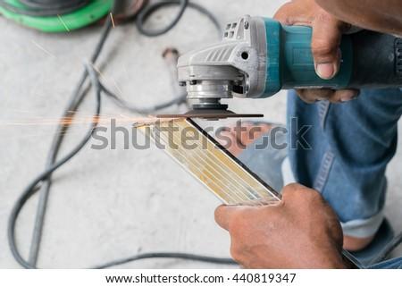 in a metal workshop - grinding  - stock photo