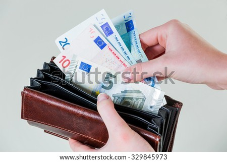 in a purse there are several euro banknotes.  - stock photo