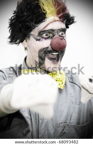 In An Entertainment Display For The Whole Family A Smiling Circus Performing Clown Does A Dark And Humorous Hand Puppet Show - stock photo