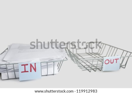 In and out desk trays in an office over white background - stock photo