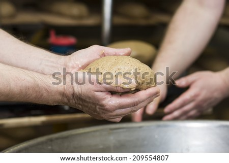 In bread bakery, food factory, manual workshop, people working together making handmade bread - stock photo