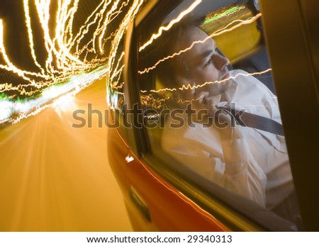 In car with telephone during the night - stock photo