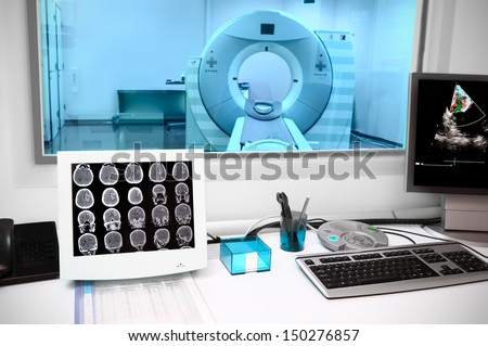in CT laboratory. Observation room in an office with a computer tomograph - stock photo