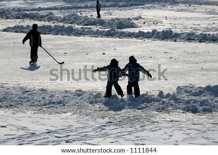 in denmark the winter with people ice skating and playing hockey - stock photo