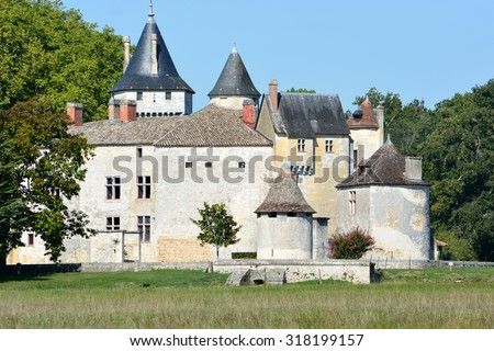 In France, Brède castle, historic monument, is situated in the middle of the Bordeaux vineyard, department of Gironde. In this domain was born Montesquieu in 1689, celebrates french philosopher. - stock photo