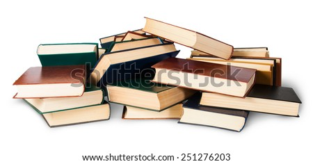 In front piled on a bunch of old books isolated on white background - stock photo