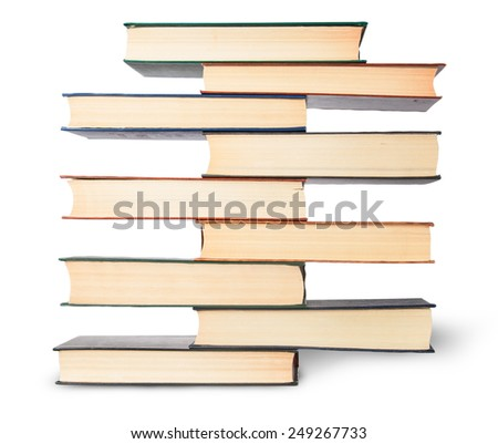 In front vertical stack in old books isolated on white background - stock photo
