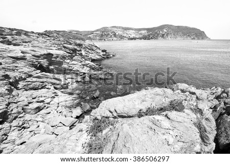 in greece the mykonos island rock sea and beach  blue sky - stock photo