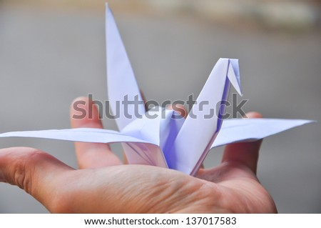 In Japan you can often see paper crane's hanged near temples. - stock photo