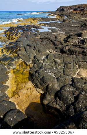 in lanzarote froth coastline  spain pond  rock stone sky cloud beach  water  musk  and summer     - stock photo