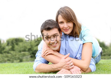 In love couple laying in public park - stock photo