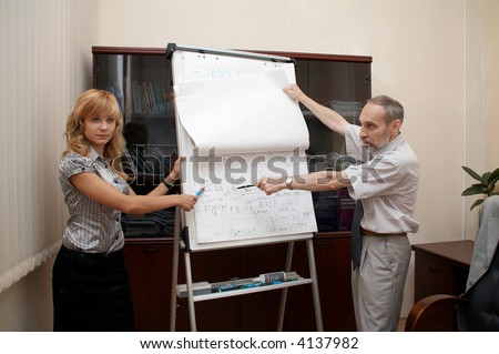 In Office. Explain future plans. Director and staff. - stock photo