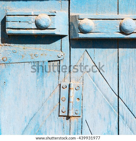 in oman antique door entrance and      decorative handle for background - stock photo
