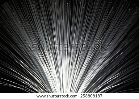 In optical fibers occurs colored light at the end. - stock photo