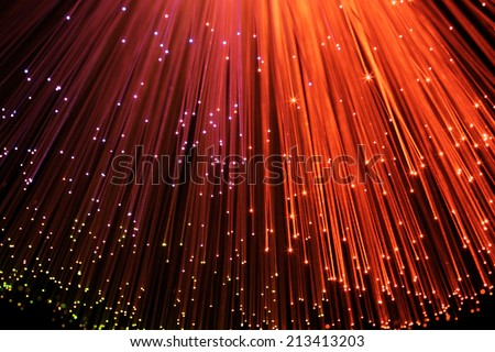 In optical fibers occurs colored light at the end. unfocused - stock photo