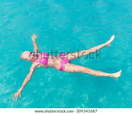 In Pink Bikini In Water  - stock photo