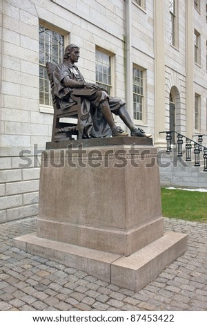"In 1884 Samuel J. Bridge presented the University with a bronze statue of John Harvard as conceived by Daniel Chester French. The statue is nicknamed ""The Statue of Three Lies."" - stock photo"
