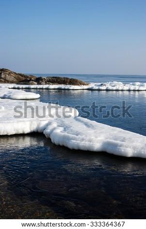 In sea ice, blocks of ice on the sea, the winter ocean, Arctic aquatic nature, ice floe in the ocean, spring in the North sea, the Arctic in the spring, wildlife. - stock photo