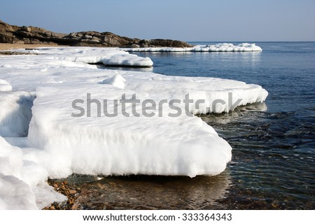 In sea ice, blocks of ice on the sea, the winter sea and the ocean, Arctic aquatic nature, ice floe in the ocean, melting ice, spring in the North sea, the Arctic in the spring, wildlife - stock photo