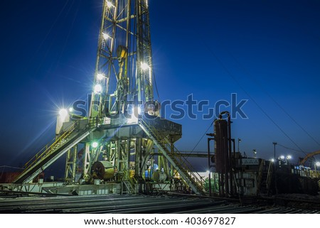 In the evening of oilfield derrick - stock photo
