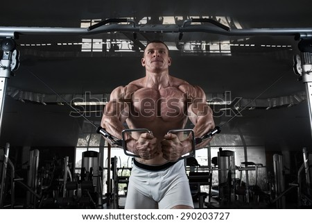 in the gym.Bodybuider demonstrate crossover exercises - stock photo