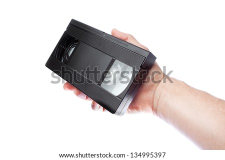 In the hand of a man old videotape format VHS. - stock photo