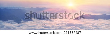 In the mountain of Pop Ivan and Smotrych among fog and oblakov- sunrise illuminating the pink rays of the slopes of the Carpathian mountains, covered with forests and rhododendrons, stones and rocks - stock photo