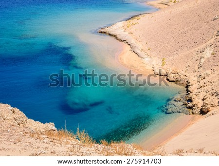 In the picture a beautiful turquoise lagoon with rocky beaches located in Egypt in the Red Sea - stock photo