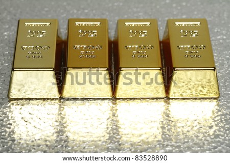 In the picture with several gold bullion is room for the added text available. - stock photo