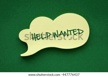 In the speech balloon on a green background Help Wanted writes - stock photo