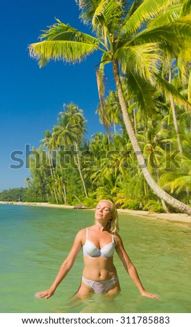 In the Summer Sunshine On a Tropical Beach  - stock photo