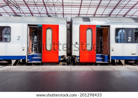 in the train station wait a train whit open doors - stock photo