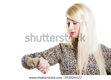 in time: Beautiful blond woman checking wrist watch isolated over white background portrait - stock photo