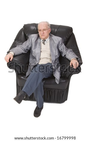 Inage of a senior man sitting in an armchair against a white background. - stock photo