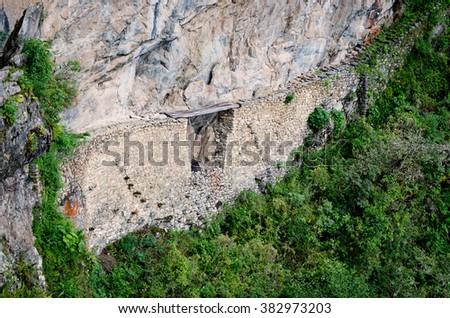 Inca bridge in Machu Picchu in Peru. UNESCO World Heritage Site - stock photo