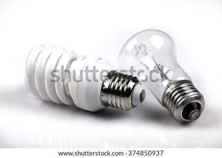 incandescent and energy saving white background - stock photo