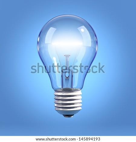 Incandescent light bulb on blue background - stock photo