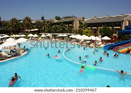 INCEKUM BEACH RESORT, ALANYA, TURKEY - JULY 04: view of entertainment complex on July 04, 2013 in Alanya, Turkey. Popular hotel resort with pools and aquaparks in Turkey.  - stock photo