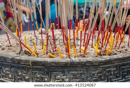 Incense  and candle in the incense burner. Temple in Thailand. selective focus. - stock photo