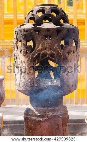 Incense Burner In thai Temple, art thai style,Incense  in the incense burner. Temple in Thailand - stock photo