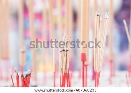 incense burner incense stick incense stick in a pot on the spot. - stock photo