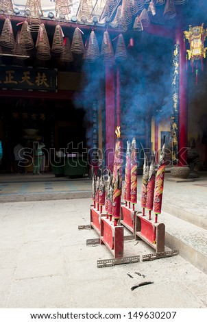 Incense Burning in a Buddhism Temple - stock photo