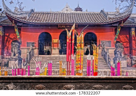 Incense Burning in a Buddhist Temple - stock photo